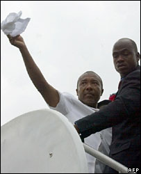 Former Liberian President Charles Taylor (waving)