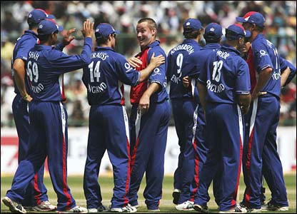 England celebrate as Ian Blackwell captures the wicket of Suresh Raina