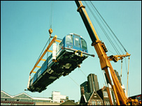 Waterloo and City line train being lowered into the depot