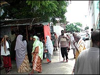 People shopping and walking along streets of Mogadishu