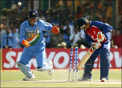 India wicketkeeper Mahendra Dhoni looks on as Geraint Jones is bowled