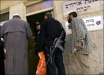 Armed settlers in the West Bank city of Hebron