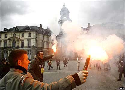 Protesters holding flares in Rennes, western France