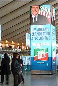 An election poster of Italian Prime Minister Silvio Berlusconi at Rome Termini station