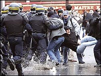 Riot police clash with protesters in Paris