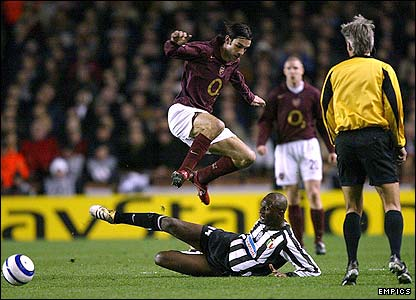 Vieira challenges Arsenal's Robert Pires