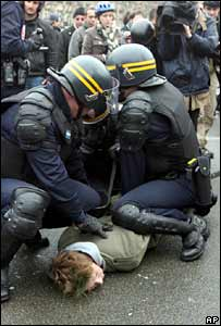 French riot police arrest a protester in Paris