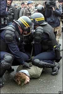Riot police arrest a protester