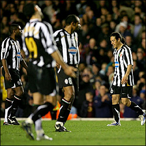 Mauro Camoranesi (right) trudges off after receiving his second yellow card