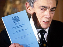 Lord Scarman with a copy of his report