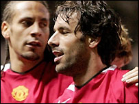 Ruud van Nistelrooy (right) celebrates scoring for Manchester United