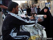 Shia Iraqis in Baghdad donate food for displaced people