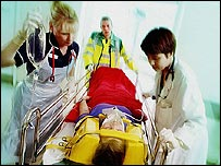 Doctor, paramedic and nurse with patient
