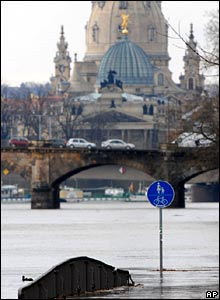 Flooded cycle ways are seen opposite the Church of Our Lady and the Art Academy building in Dresden