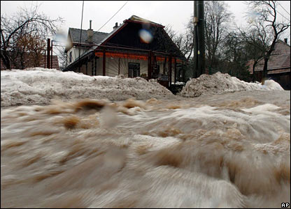 Water pours down the street in the village of Stara Myjava