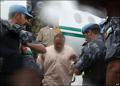 Charles Taylor disembarks from a Nigerian plane at an airport in Monrovia, Liberia (UN photo)