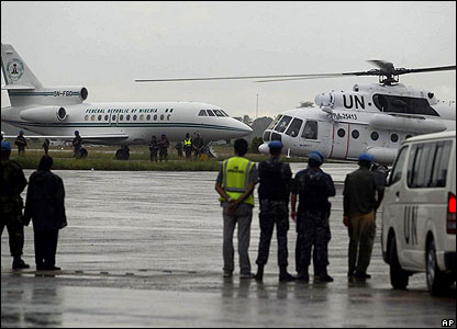 A plane and helicopter at an airport in Monrovia, Liberia