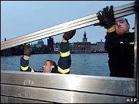 Firemen erect barrier in Prague's medieval Kampa district