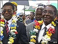 Equatorial Guinea President Teodoro Obiang Nguema Mbasogo and Zimbabwe's Robert Mugabe in 2006