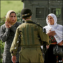 Palestinian women argue with an Israeli soldier at Hebron
