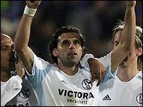 Brazilian Lincoln (centre) celebrates scoring for Schalke
