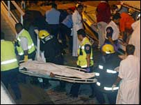 Rescue teams carry the body in Bahrain