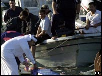Rescue workers pull debris from scene of boat in Bahrain