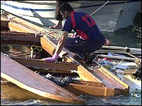 Rescue workers search wreckage