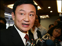 Thai Prime Minister Thaksin Shinawatra answering reporters' questions in Bangkok