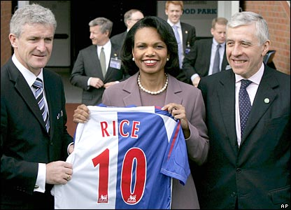 Condoleezza Rice is presented with a Blackburn Rovers football shirt by team manager Mark Hughes