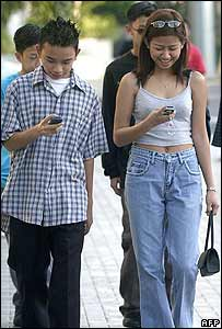 People sending text messages in the Philippines