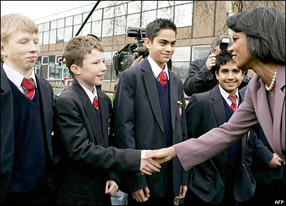 Condoleezza Rice is greeted by pupils from Pleckgate High School in Blackburn