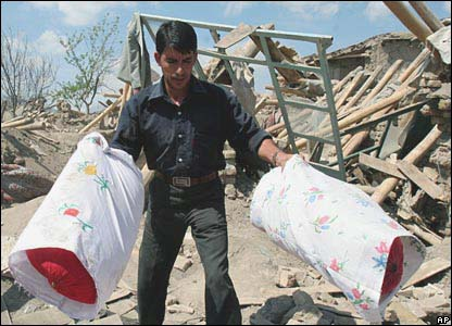 A man searches among the rubble