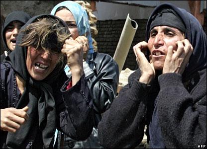 Women wail amid the devastation