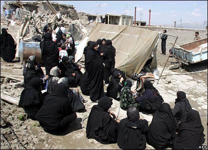 Women gather amid the devastation