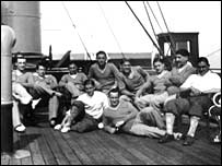 Members of the France squad relax on the long journey to the World Cup
