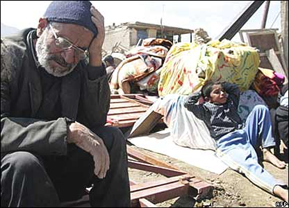 Survivors sit in shock after Iranian earthquake