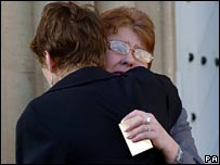 Bereaved mother Pat Long is comforted