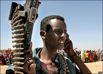 A Somali man talks on his phone at a food distribution centre for the United Nation's World Food Programme in Rabdure district, 400km west of the capital, Mogadishu.