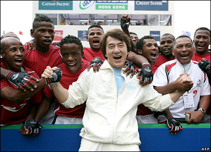 Jackie Chan (front) with members of Madagascar's rugby team in Hong Kong.