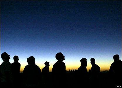 Libyan young men watch the solar eclipse in the desert in Galo on 29 March 2006.
