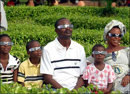 A family views the eclipse from the town of Abomey in Benin on Wednesday.