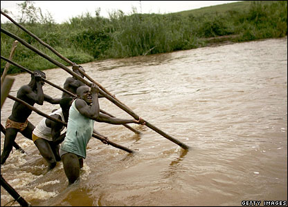 People mining for gold in a river in DR Congo.
