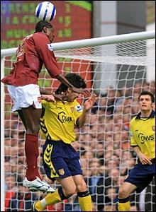 Emmanuel Adebayor heads home the opening goal of the game