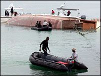 Rescue workers continue to search the wreckage of the Bahrain boat