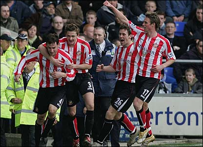 Rory Delap is mobbed by his team-mates