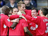 Liverpool celebrate after Djibril Cisse puts them 2-0 up against West Brom