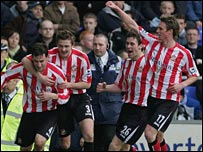 Rory Delap is mobbed after heading Sunderland's late equaliser