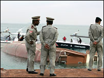 Bahraini police officers by the wreckage of the capsized boat