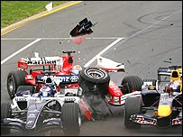 Nico Rosberg's Williams, Felipe Massa's Ferrari and the Red Bull of Christian Klien tangle on the first lap in Melbourne